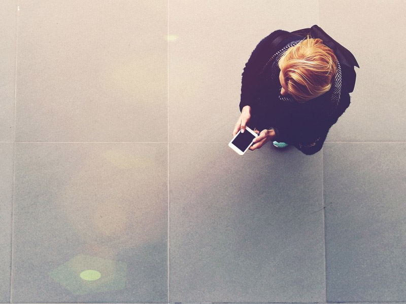 Person consulting their smartphone